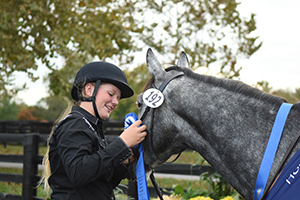 Franny placing her first place ribbon on Little.