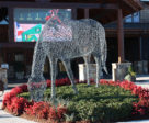 This wire equine statue graces the front entrance to Legends Grille, which overlooks the current main arena.