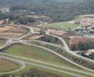 The area roads are being improved to allow better traffic flow, including this new traffic circle near the entrance.