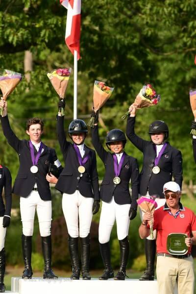 Thumbnail for Gold Jumping medals for Canadian Young Riders at NAYC