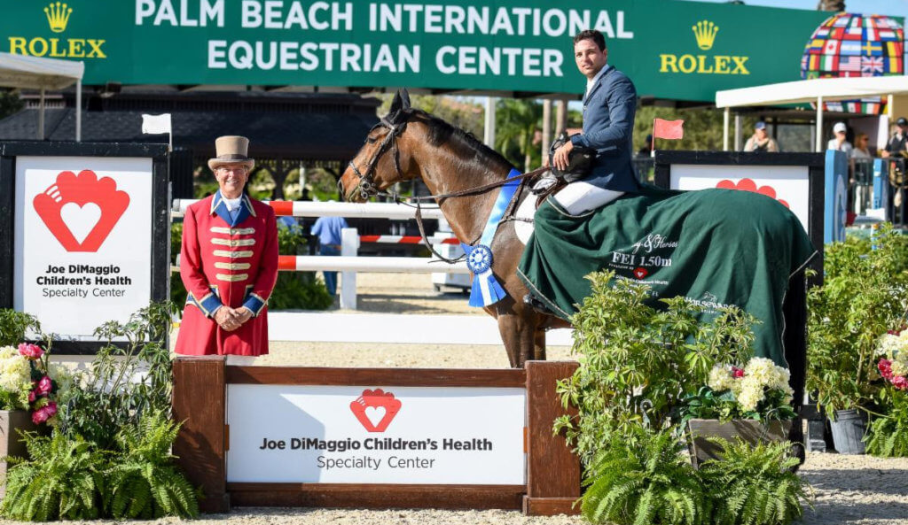 Daniel Bluman claimed first place aboard Colestina H in the $72,000 Joe DiMaggio Children's Health Specialty Center 1.50m Qualifier. Pictured with ring master, Steve Rector. (©ESP)