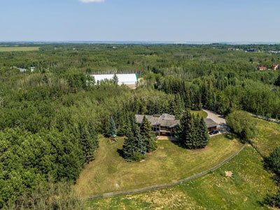 Thumbnail for $1,699,900 for 20 treed acres with 6-stall barn near Calgary, Alberta