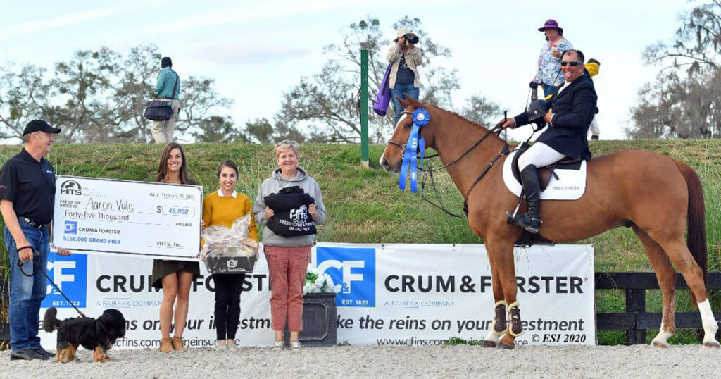 Nigel Wallbank and his pup 'Guinness' of Crum & Forster presented Aaron Vale with the prize check.