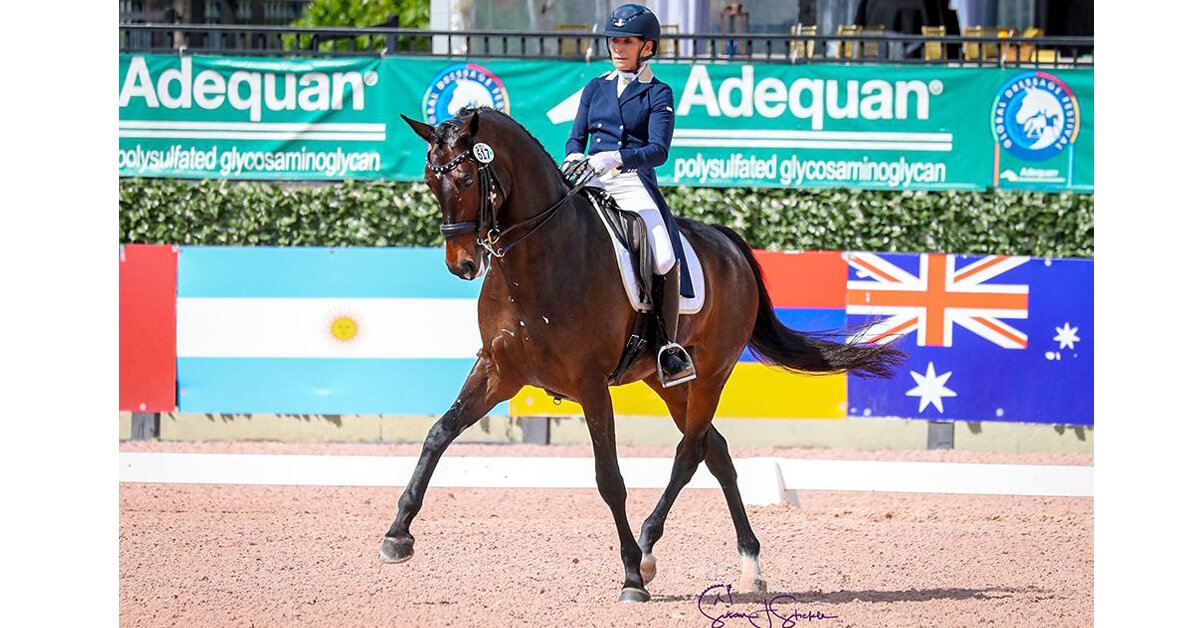 Betsy Steiner (USA) and Swiss W are the final winners down the center line for AGDF 2020, claiming the FEI Intermediate I Freestyle CDI3* with over 75%. ©️Susan Stickle.