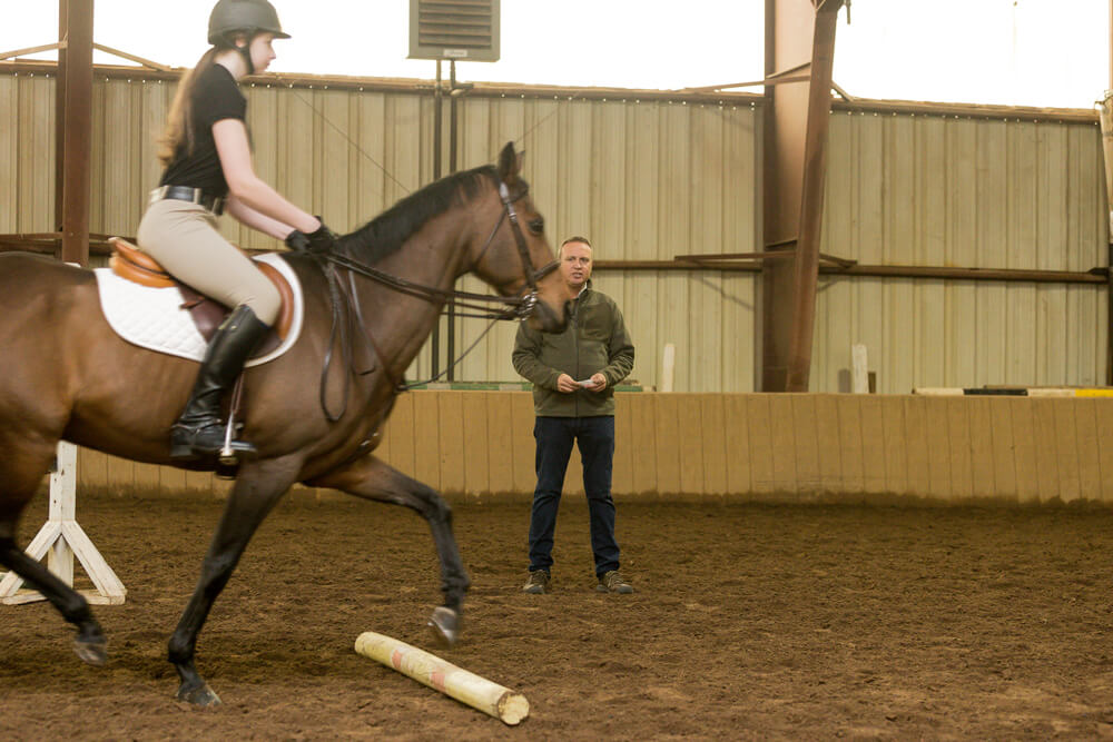"""The """"Between Two Poles"""" exercise is a great choice for all levels. This rider maintains a straight line and is ready for the next corner. (Lindsay Brock/Karin Dolan photos)"""