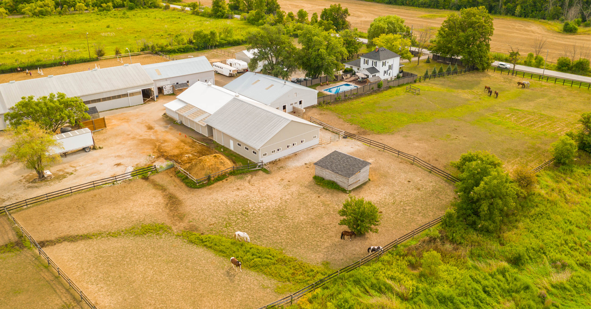 Thumbnail for $3,299,900 for country-chic home on equestrian estate with 40-stall barn and two indoor arenas.